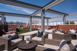 Enjoy happy hour with neighbors in our rooftop lounge.
